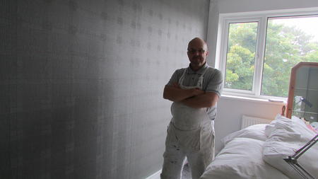 wallpapering bedroom