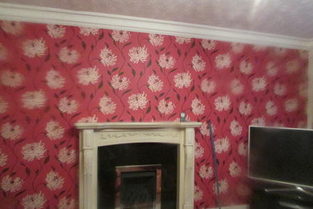 floral wallpapering front room