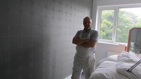 wallpapering bedroom